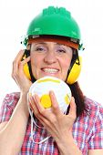 pic of female mask  - Smiling female construction worker with protective mask wearing green helmet and protective headphones safety at work and ear protection - JPG