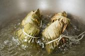 picture of chinese wok  - Zongzi boiling in a wok - JPG