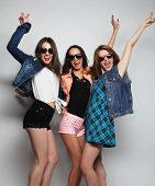 stock photo of three sisters  - Fashion portrait of three stylish sexy hipster girls best friends - JPG