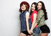 foto of three sisters  - Three stylish sexy hipster girls best friends - JPG
