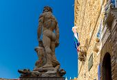 stock photo of hercules  - White sculpture Hercules and Cacus by  Baccio Bandinelli on  Piazza della Signoria in Florence at day - JPG