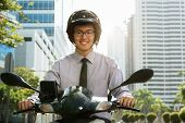 stock photo of commutator  - Young asian businessman commuting to job - JPG