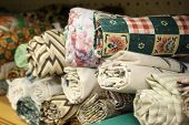 pic of quilt  - Small rolls of colorful fabric for a quilt - JPG