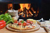 image of hot fresh pizza  - fresh baked tasty pizza near wood oven - JPG