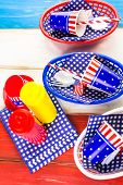 stock photo of barbie  - Table set with white blue and red decorations for July 4th barbecue - JPG
