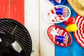 foto of barbie  - Table set with white blue and red decorations for July 4th barbecue - JPG