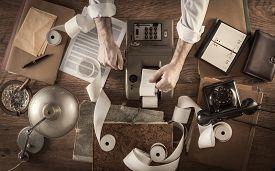 foto of calculator  - Messy vintage accountant - JPG