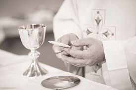 foto of marriage ceremony  - Black and white artistic digital photo of Catholic priest in church wedding marriage ceremony.
