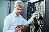 network engineer administrator in server room poster