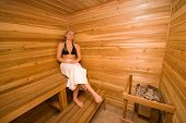 picture of sauna woman  - cute woman relaxing in the wood sauna - JPG
