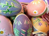 stock photo of ostara  - Various seasonal festive painted eggs in different colours - JPG