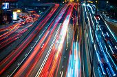 blurred traffic in downtown district,hong kong,china.Chinese characters on road are all traffic road poster