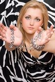 Pretty Blonde Stretches Out Her Hands In Chains