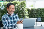 Smiling Happy Mature Man With White Stylish Short Beard Using Smartphone Gadget Serving Internet At  poster
