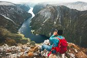 Man Backpacker Using Smartphone Relaxing On Mountain Top Traveling Alone In Norway Adventure Lifesty poster