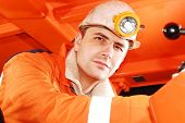 foto of gold mine  - Miner at his workplace portrait stock photo - JPG