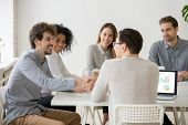 Two Smiling Businessmen Or Project Team Members Shaking Hands At Multiracial Group Meeting, New Male poster