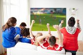 sport, leisure and entertainment concept - friends or football fans watching soccer on projector scr poster