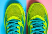Pair Of Sport Shoes On Colorful Background. New Sneakers On Pink And Blue Pastel Background, Copy Sp poster
