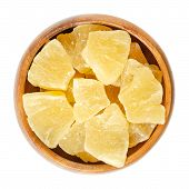 Candied Pineapple Pieces In Wooden Bowl. Crystallized Chunks Of Ananas Comosus. Yellow Colored Flesh poster
