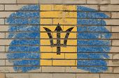 Flag Of Barbados On Grunge Brick Wall Painted With Chalk