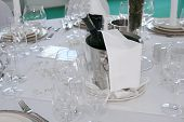 image of wedding table decor  - Elegant dinner table with Cooling champagne or wine - JPG