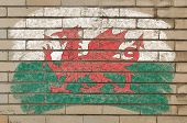Flag Of Wales On Grunge Brick Wall Painted With Chalk