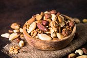 Assortment Of Nuts In Wooden Bowl. Cashew, Hazelnuts, Walnuts, Almonds, Brazilian Nuts And Pine Nuts poster