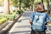 Summer Lifestyle Portrait Of Young Tourist Asian Woman Walking On The Street, Carry Backpack. Travel poster