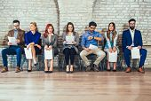 Photo Of Candidates Waiting For A Job Interview poster