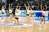 Cheerleaders perform routines