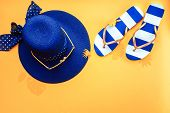 Beach Hat, Sunglasses And Sandals On A Bright Yellow Background. Summer Vacation Flat Lay With Copy  poster