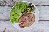 Homemade Cooking Of Pork Chop Steak Served With Mixed Vegetable As Red Oak , Green Oak And Lettuce poster