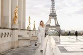 Pretty Cauvasian Woman Walking On Trocadero Square Near Gilded Statues And Eiffel Tower In Paris. Co poster