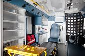 Empty ambulance interior with equipment on bench
