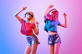Dj Girl With Pink Blond Fashion Hairstyle Dance. Two Young Playful Hipster In Trendy Headphones. Sex poster
