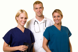 foto of medical assistant  - Two woman healthcare workers with one male in the middle wearing a doctors lab coat - JPG