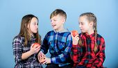 Promoting Healthy Nutrition. Boy And Girls Friends Eat Apple. Teens With Healthy Snack. Group Teenag poster