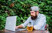 Computer Technology Makes Life Easier. Hipster Drinking Beer And Using Laptop Technology Outdoor. Be poster