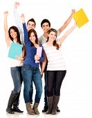 Happy group of college students with arms up - isolated over white