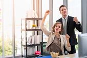 Mission Accomplished. Businesswoman And Businessman Are Happy And Raise Their Hands In Work Space Wi poster