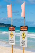 Man O War And Strong Current Warning Signs On Waimanalo Beach On Oahu, Hawaii poster
