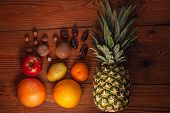 Tropical Fruits And Nuts Vegan Diet. Pineapple, Grapefruit, Orange, Pear, Walnuts On Wooden Backgrou poster