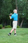 Young male teen golfer with great form