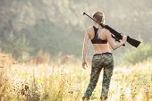Back View Sexy Military Fashion Girl With Rifle With An Optical Sight. Female Chase Sport Hunter In  poster