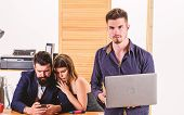 Enjoy A Full Mobile Laptop Experience. Businessman Using Laptop While Collegues Using Smartphone Mob poster