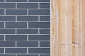 Wall from wood plank and gray brick