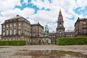 Christiansborg Palace and equestrian statue of Danish King Christian IX in Copenhagen, Denmark.