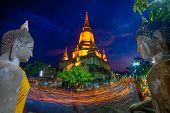 Unidentified Buddhists Making Candle Light Procession Around The Pagoda  In Wat Yai Chaimongkon, The poster