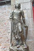 Statue Of Joan Of  Arc In The Abbey Of Mont Saint Michel. Normandy, France